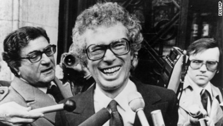 FILE - In this Jan. 31, 1980, file photo, Ken Taylor, Canadian Ambassador to Iran, laughs as he answers questions during a meeting with journalists outside the Canadian Embassy in Paris. Taylor, who kept Americans hidden at his residence during the 1979 Iran hostage crisis, died Thursday, Oct. 15, 2015, after a two month battle with colon cancer, his wife Pat said. He was 81. (AP Photo/File)