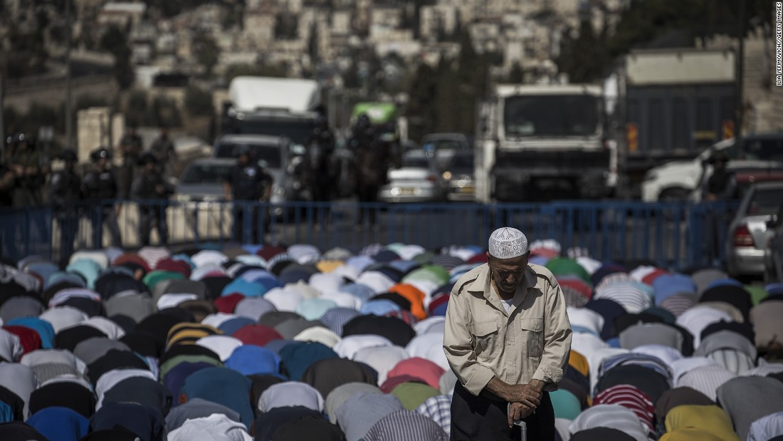Palestinians kneel during noon prayers in Jerusalem on October 16.
