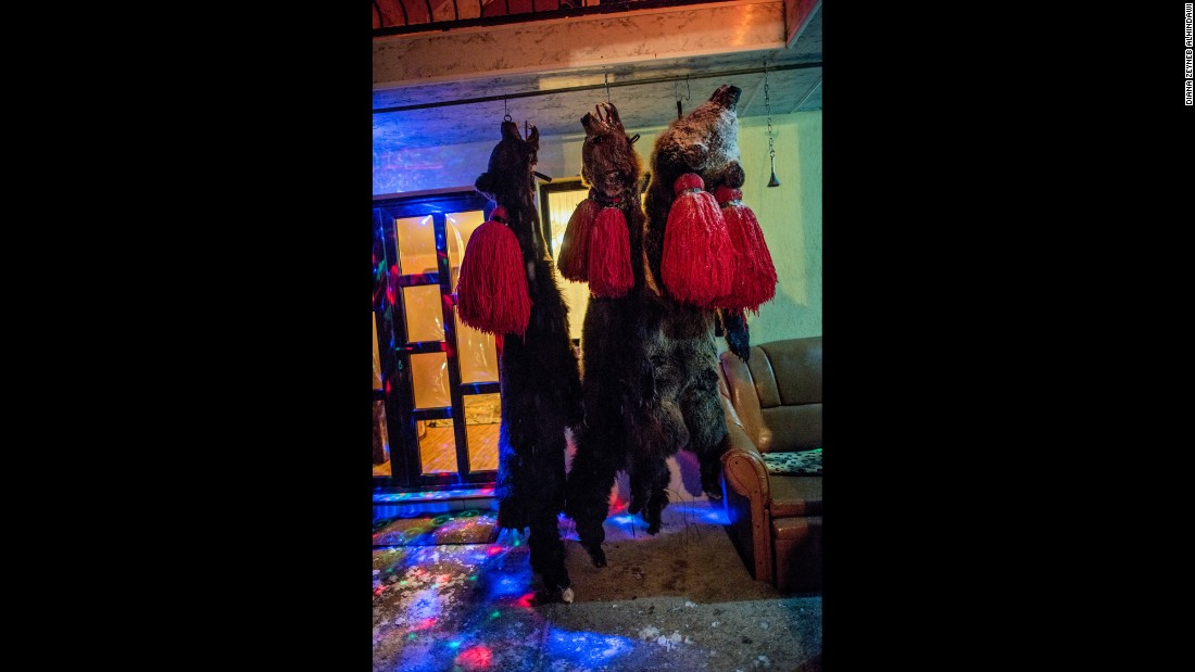 At the end of each night, bearskins hang from hooks on the ceiling of a front porch.