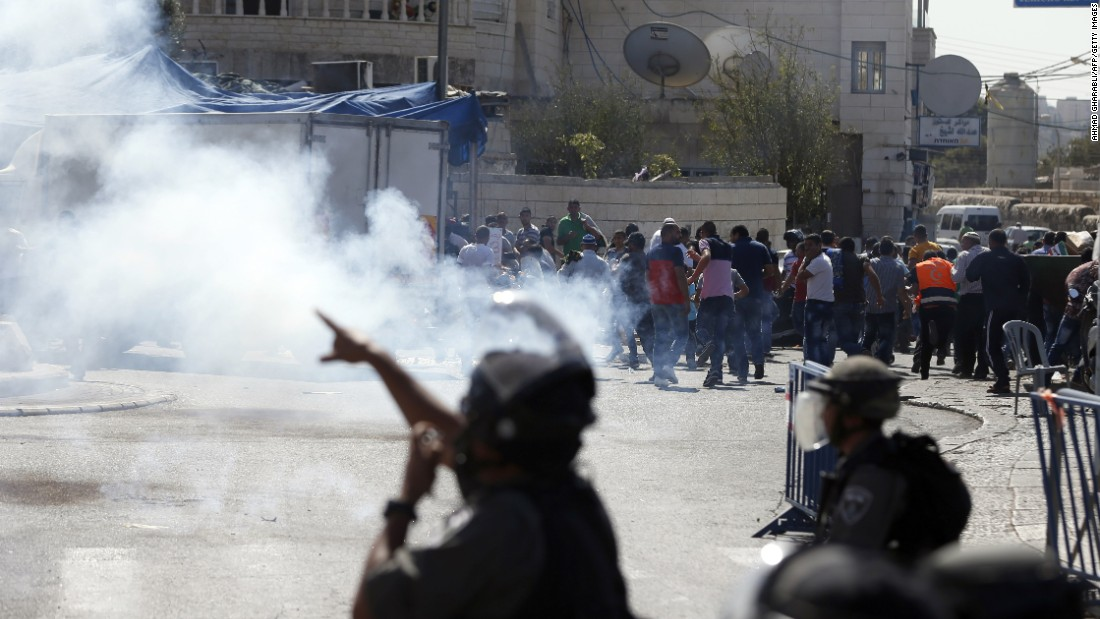 Israeli security forces fire tear-gas canisters and stun grenades toward Palestinian protesters in east Jerusalem on October 16.