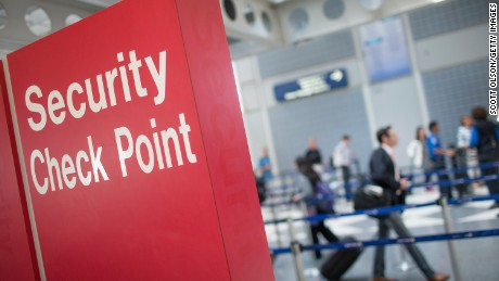 A sign directs travelers to a security checkpoint staffed by Transportation Security Administration workers at O'Hare Airport on June 2, 2015 in Chicago, Illinois.