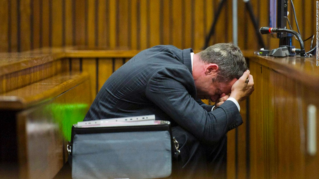 Pistorius puts his head in his hands during his trial in South Africa in March 2014. Pistorius often showed great emotion as the court went into detail about Steenkamp's death.