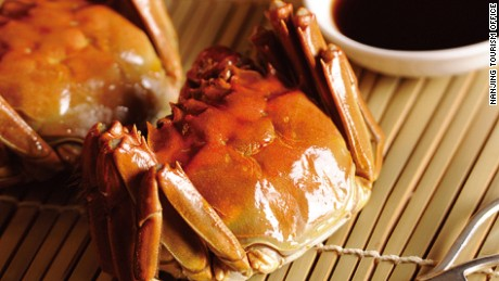 Pull the legs and claws off before prising open the shell.