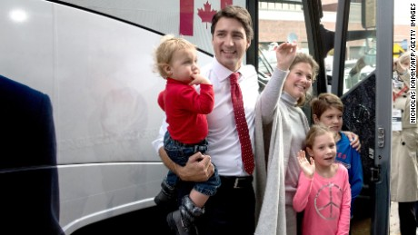 Canadian Liberal Party leader Justin Trudeau leaves after casting his ballot with his wife Sophie and their children Hadrien(L), Ella-Grace(2nd-R) and Xavier(R) in Montreal on October 19, 2015. The first of 65,000 polling stations opened Monday on Canada's Atlantic seaboard for legislative elections that pitted Prime Minister Stephen's Tories against liberal and social democratic parties. Up to 26.4 million electors are expected to vote in 338 electoral districts. Some 3.6 million already cast a ballot in advance voting a week ago, and the turnout Monday is expected to be high.   AFP PHOTO/NICHOLAS KAMM        (Photo credit should read NICHOLAS KAMM/AFP/Getty Images)