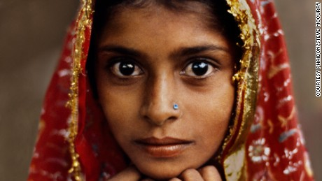 Portrait of a young girl in red, Steve McCurry.