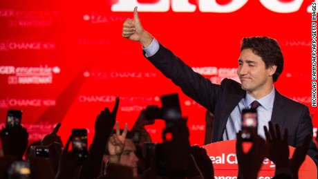 Canadian Liberal Party leader Justin Trudeau waves on stage in Montreal on October 20, 2015 after winning the general elections.    AFP PHOTO/NICHOLAS KAMM        (Photo credit should read NICHOLAS KAMM/AFP/Getty Images)