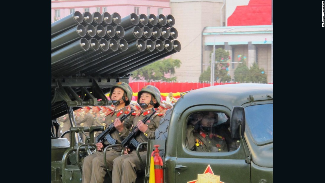 Young faces of North Korea's military ride artillery through Pyongyang.