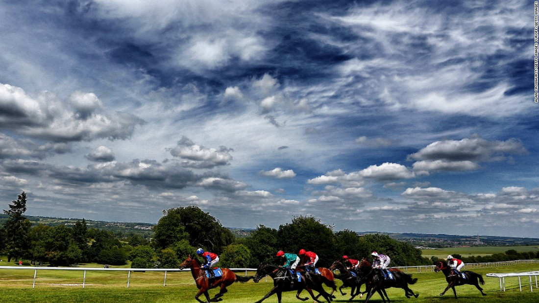 Silvestre De Sousa riding Montsarrat (second left, green) wins the Ashbrittle Stud EBF Stallions Blagrave Maiden Stakes at Salisbury racecourse in June 2015. Racing has taken place at Salisbury since the sixteenth century. The Brazilian jockey won this year's 2015 flat jockeys' championship.