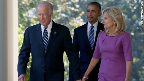 Vice President Joe Biden, followed by President Barack Obama, holds hands with his wife, Jill, while walking to the Rose Garden to announce that he will not seek the presidency on October 21, 2015.