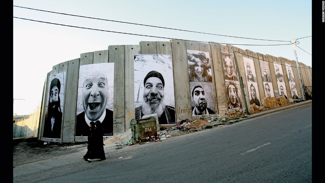 French Artist JR captured a series of photographs of Palestinian and Israeli people that he met on his travels to the Middle East in 2005. In 2007, he plastered the images on walls in cities across Israel and Palestine.