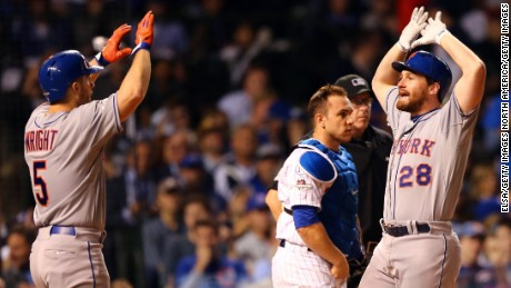 CHICAGO, IL - OCTOBER 21:  Daniel Murphy #28 of the New York Mets celebrates with David Wright #5 after hitting a two run home run in the eighth inning against the Chicago Cubs during game four of the 2015 MLB National League Championship Series at Wrigley Field on October 21, 2015 in Chicago, Illinois.  (Photo by Elsa/Getty Images)