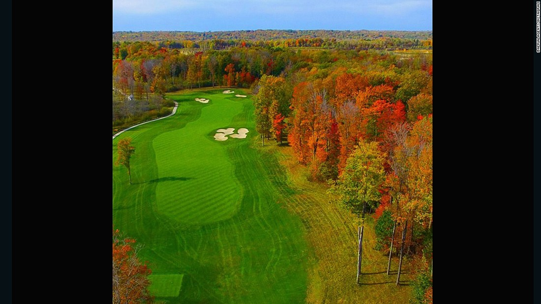 "Our second entry comes from <a href=""https://instagram.com/aerialagents/"" target=""_blank"">@aerialagents</a>. ""One of the most visually impressive holes on this Tom Fazio designed course,"" they explain. ""Sand Ridge Golf Club is built on 370 acres of woods, pastures and wetlands."" The vast array of colors in the trees are evidence of this."