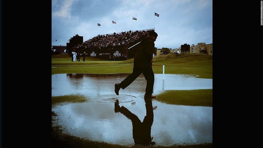 "CNN's <a href=""https://instagram.com/murpho2005/"" target=""_blank"">Chris Murphy </a>captured this shot at St. Andrews soon after the deluge. The gray skies and man skipping through the puddle illustrate just how quickly the rain fell and waterlogged the course. ""A tad wet at St Andrews on Friday. All adds to the fun, when you're sitting in the warm & toasty media center anyway,"" he said."