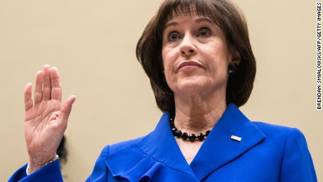 Lois Lerner, former director of the Tax Exempt and Government Entities Division at the Internal Revenue Service(IRS), is re-sworn-in for a continuation of a hearing of the House Oversight and Government Reform Committee on Capitol Hill March 5, 2014 in Washington, DC. The committee held the hearing to see if the Internal Revenue Service has been targeting US citizens based on their political beliefs.  Lerner once again invoked her Fifth Amendment right not to testify.  AFP PHOTO/Brendan SMIALOWSKI        (Photo credit should read BRENDAN SMIALOWSKI/AFP/Getty Images)