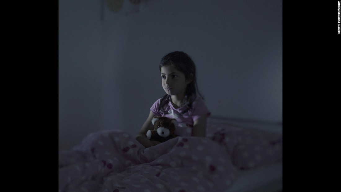 Fatima, 9, sits in bed in Norberg, Sweden. Every night, she said, she dreams that she's falling from a ship. After two years at a refugee camp in Lebanon, Fatima and her family boarded an overcrowded boat in Libya. On the deck of the boat, a woman gave birth to her baby after 12 hours in the scorching sun. The baby was stillborn and thrown overboard. Fatima saw everything. When their boat started to take on water, they were picked up by the Italian Coast Guard.