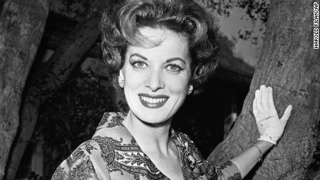 """FILE - This Jan. 19, 1960 file photo shows movie actress Maureen O'Hara photographed in her front yard in Los Angeles. O'Hara,who appeared in such classic films as """"The Quiet Man and How Green Was My Valley,"""" has died. Her manager says OHara died in her sleep Saturday, Oct. 24, 2015 at her home in Boise, Idaho.  (AP Photo/Harold Filan,File)"""