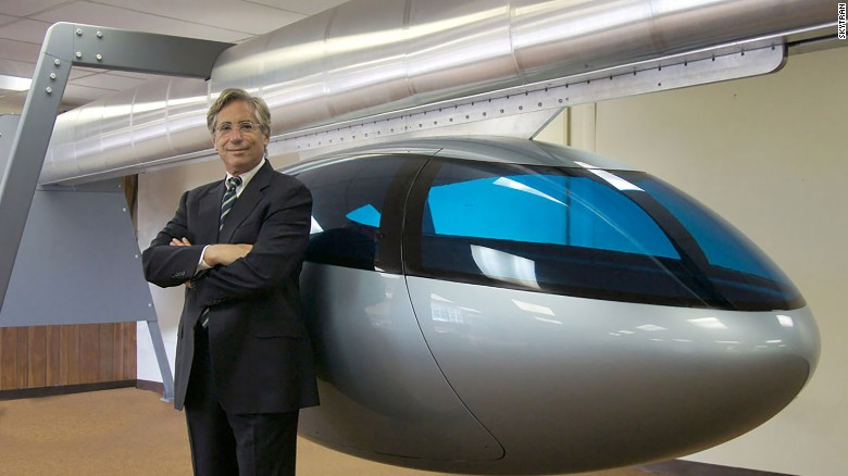 Jerry Sanders, CEO of SkyTran, with the magnetically-operated SkyTran car.