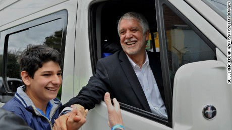Bogota's Mayor Candidate Enrique Penalosa greets supporters after casting his vote on October 25, 2015. Colombians went to the polls Sunday to elect provincial governors and hundreds of local officials who will have a crucial role in implementing any peace agreement reached with leftist FARC rebels. AFP PHOTO / GUILLERMO LEGARIA        (Photo credit should read GUILLERMO LEGARIA/AFP/Getty Images)