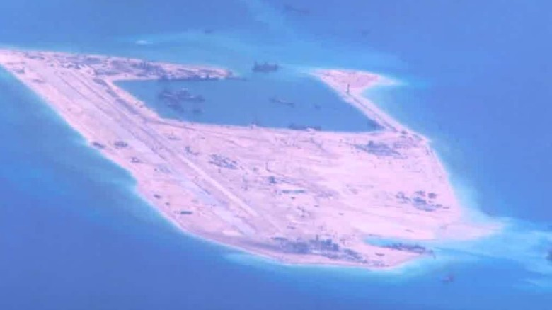U.S. destroyer passes island in South China Sea