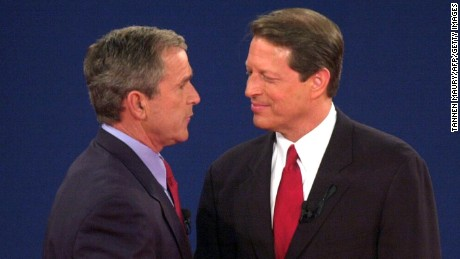 ST. LOUIS, UNITED STATES:  Republican presidential nominee George W. Bush (L) shakes hands with Democratic presidential nominee Al Gore after their third debate at Washington University in St. Louis, MO, 17 October, 2000. This is the last debate between the candidates before the 07 November election.    AFP PHOTO/Tannen MAURY (Photo credit should read TANNEN MAURY/AFP/Getty Images)