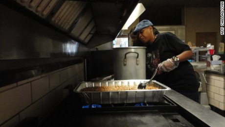 Pamela Burrell cooks baked beans for women and children in need at this Atlanta church