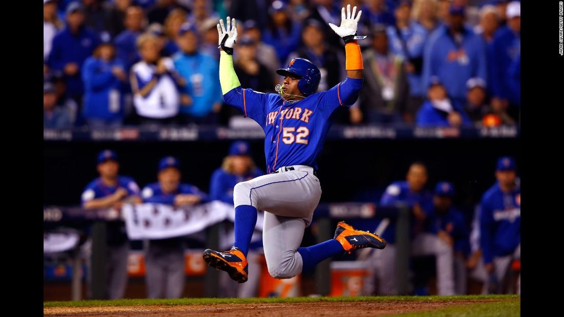 Mets outfielder Yoenis Cespedes  scores a run.