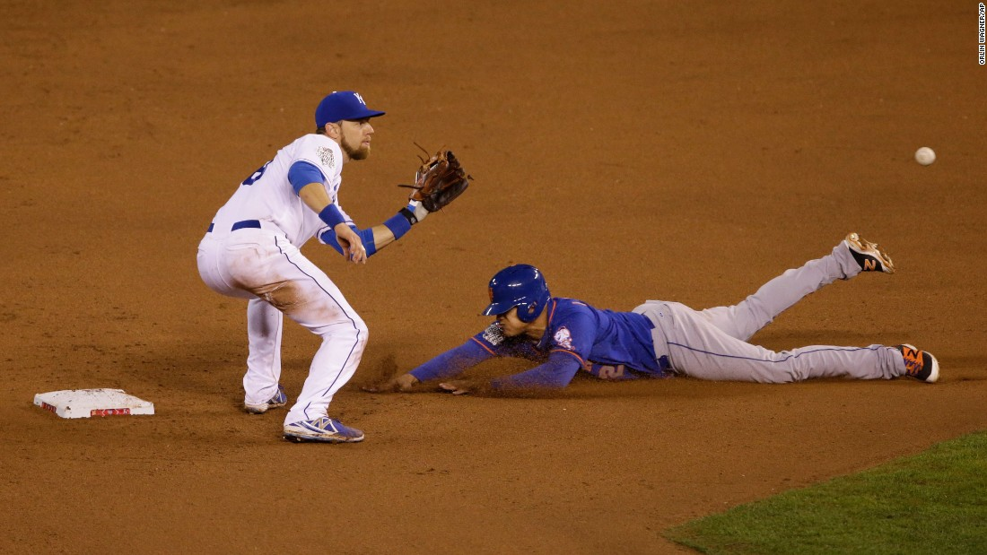 Mets center fielder Juan Lagares steals second base on a late throw to Ben Zobrist of the Royals.