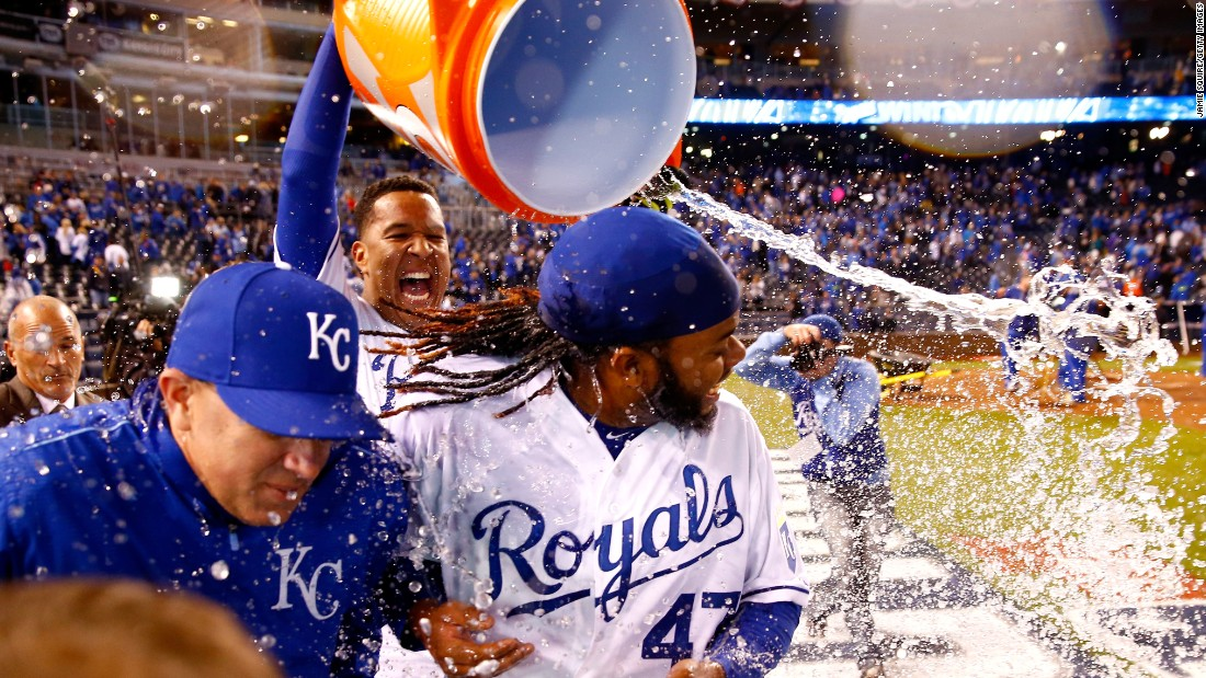 "Salvador Perez of the Kansas City Royals douses Johnny Cueto after the team defeated the New York Mets 7-1 in <a href=""http://www.cnn.com/2015/10/28/us/world-series-mets-royals-game-2/index.html"" target=""_blank"">Game 2 of the World Series</a> in Kansas City, Missouri, on Wednesday, October 28."