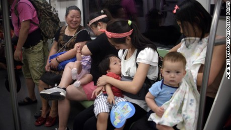 Mothers breastfeed their babies in a subway during an event of the world breastfeeding week on August 1, 2015.  Around 20 mothers breastfed their babies in a subway to promote the support of women to combine breastfeeding and work.   AFP PHOTO / JOHANNES EISELE        (Photo credit should read JOHANNES EISELE/AFP/Getty Images)