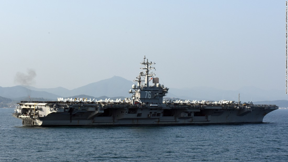 Sailors aboard the U.S. Navy's only forward-deployed aircraft carrier, the Nimitz-class USS Ronald Reagan (CVN 76), man the rails while participating in the South Korean Navy's Fleet Review on October 23 in Busan.