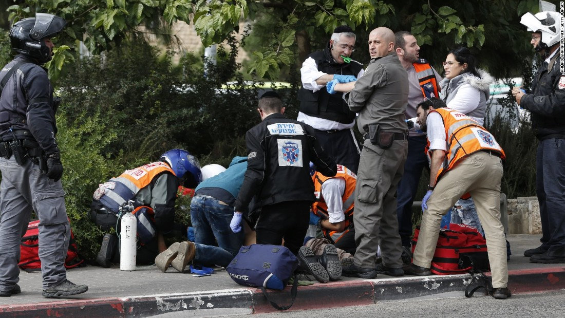 Israeli security forces and emergency personnel attend to an Israeli victim of a Palestinian stabbing attack in Jerusalem on October 30. A Palestinian stabbed two Israelis in Jerusalem before being shot, police and the army said, in the first knife attack in the city in two weeks.