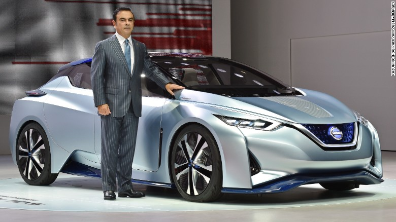 Nissan CEO Carlos Ghosn stands next to the manufacturer's IDS Concept, which drove onto the stage by itself.