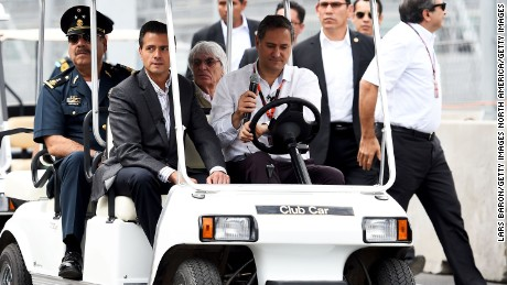 MEXICO CITY, MEXICO - OCTOBER 29:  F1 supremo Bernie Ecclestone arrives in the pit lane with the President of Mexico, Enrique Pena Nieto during previews to the Formula One Grand Prix of Mexico at Autodromo Hermanos Rodriguez on October 29, 2015 in Mexico City, Mexico.  (Photo by Lars Baron/Getty Images)