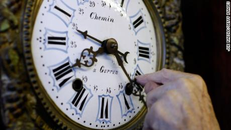 PLANTATION, FL- NOVEMBER 02:  Howie Brown adjusts the time on a clock back one hour for the end of day light savings time at Brown's Old Time Clock Shop November 2, 2007 in Plantation, Florida. The end of daylight-saving time goes into effect this weekend and everyone is reminded to set their clock back one hour beginning at 2 am Sunday.  (Photo by Joe Raedle/Getty Images)