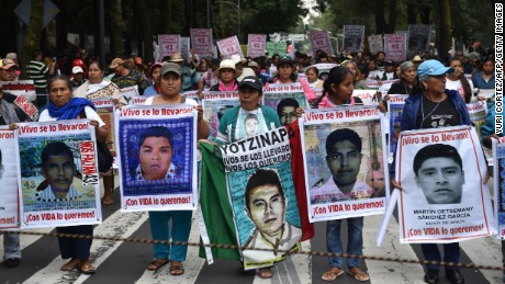 Fathers and relatives of the 43 missing students from Ayotzinapa school take part in a protest in Mexico city, on September 26, 2015, to commemorate the first anniversary of their disappearance. The students, from a rural teachers college in the southern state of Guerrero, disappeared after they were attacked by local police in the city of Iguala on September 26, 2014.  AFP PHOTO/YURI CORTEZ        (Photo credit should read YURI CORTEZ/AFP/Getty Images)