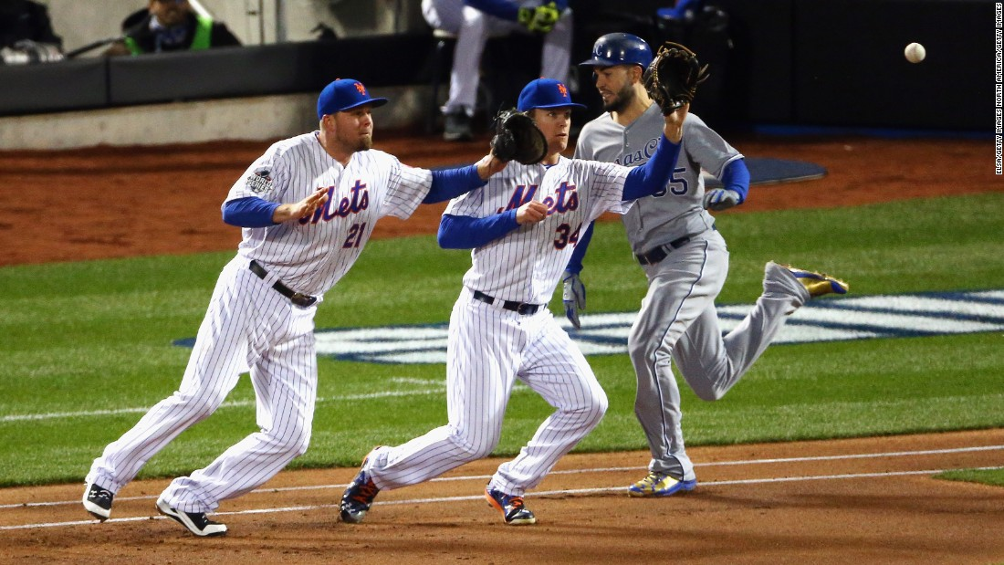 The Royals' Eric Hosmer is safe at first as the Mets' Noah Syndergaard, center, and Lucas Duda fail to make a play.
