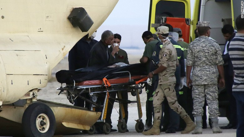 Egyptian emergency workers unload bodies of victims from the crash of a Russian aircraft carrying 217 passengers and 7 crew members over the Sinai peninsula from a police helicopter to ambulances at Kabrit airport in Suez, some 20 miles north of Suez, Egypt, Saturday, Oct. 31. A Russian Metrojet plane crashed Saturday morning in a mountainous region in the Sinai after taking off from Sharm el-Sheikh, killing all 224 people aboard. Officials said the pilot had reported a technical problem and was looking to make an emergency landing before radio contact with air traffic controllers went dead.