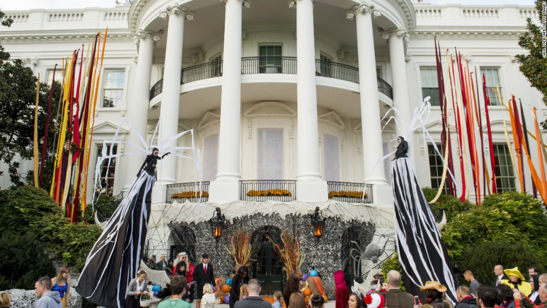 Obama and the first lady join a crowd of trick-or-treaters on the South Lawn of the White House on October 30.