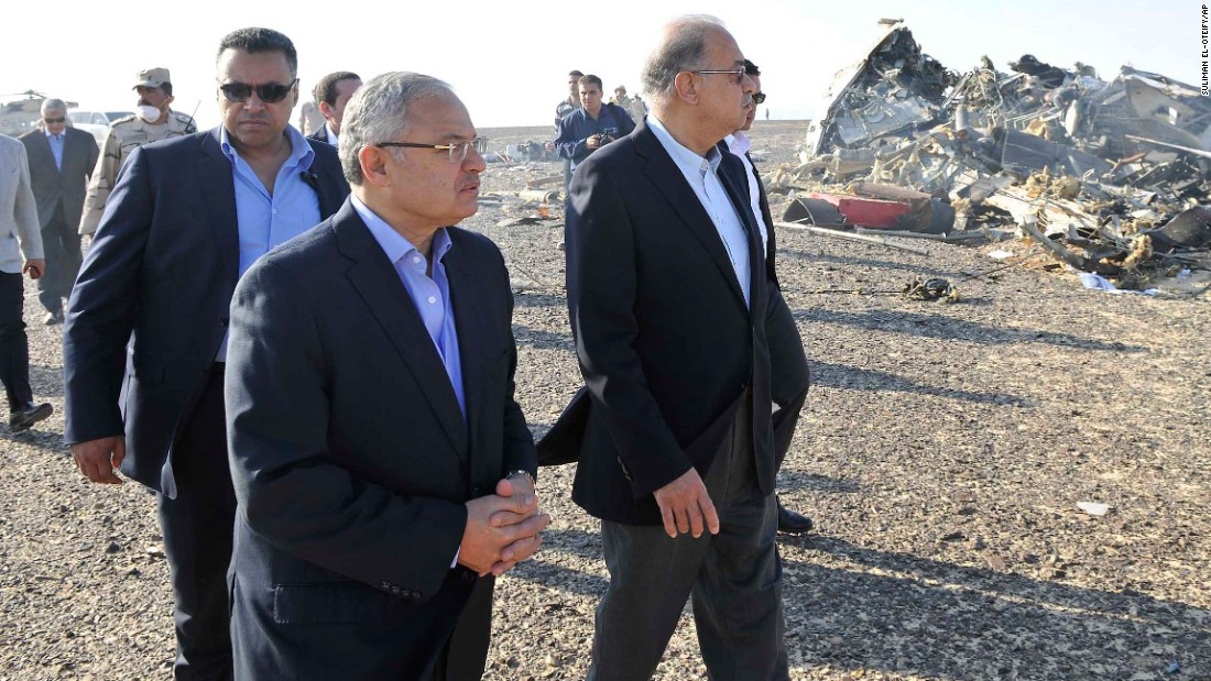 Ismail, center, and other officials visit the site of the plane crash on October 31.