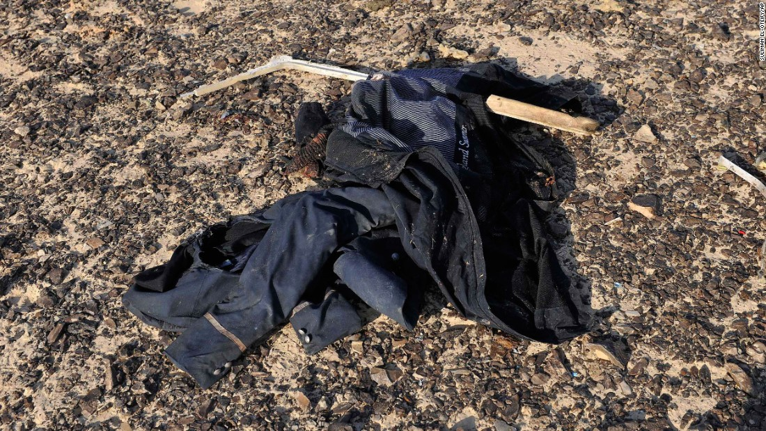 An item of clothing lies at the site where the plane crashed on October 31.