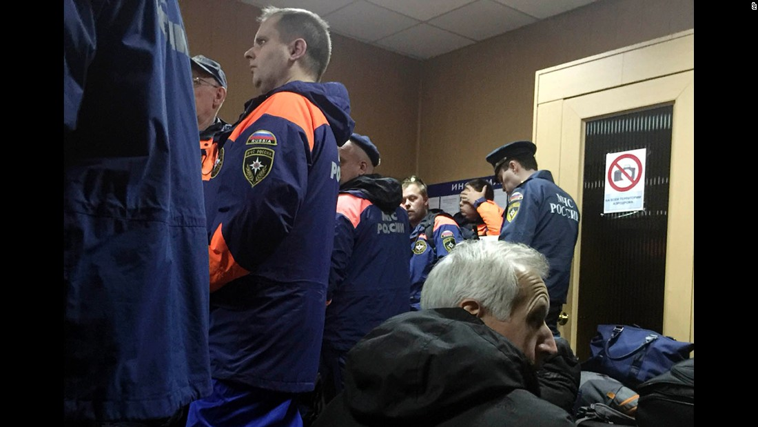 Employees with the Russian Ministry for Emergency Situations wait in Moscow for their flight to Egypt on October 31.