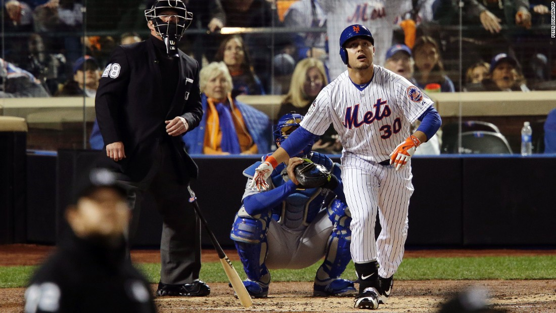 The Mets' Michael Conforto watches his home run during the third inning.