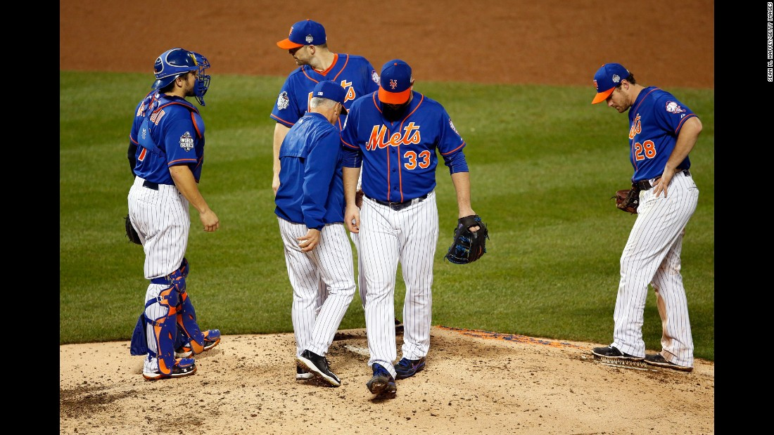 Matt Harvey, the Mets starting pitcher for Game 5, walks off the mound after being relieved in the ninth inning.