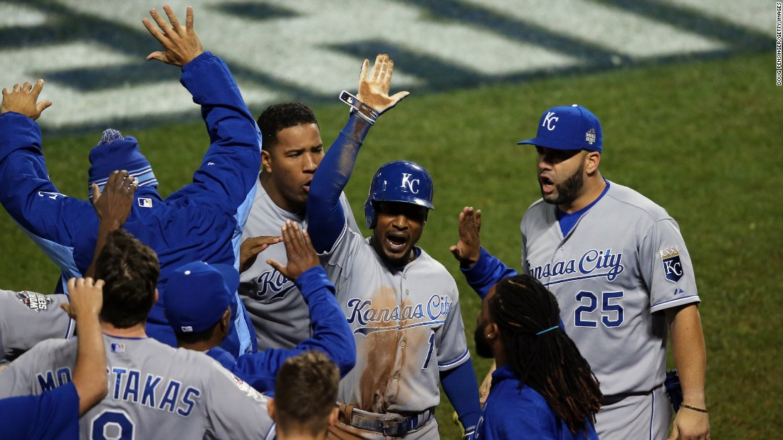 Kansas City's Jarrod Dyson celebrates after scoring the go-ahead run hit by Christian Colon in the 12th inning.