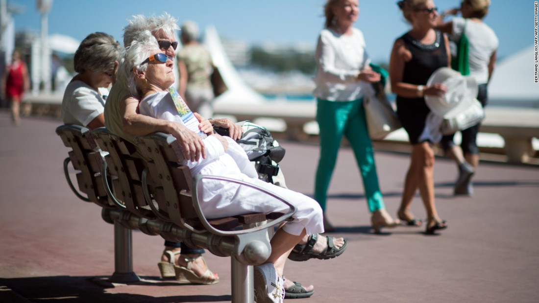 France also tied second with the other countries in southern Europe with, those over 60 living to the age of 85, on average. Pictured, a couple sit on a bench in Cannes.