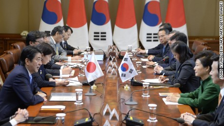 Japanese Prime Minister Shinzo Abe (L) talks with South Korean President Park Geun-Hye (R) during their meeting at the presidential house in Seoul on November 2, 2015.  Park sat down to her first summit with Abe after an extended period of deep diplomatic rancour and mistrust.  AFP PHOTO / POOLSONG KYUNG-SEOK/AFP/Getty Images