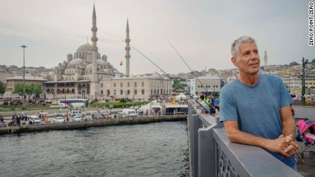 Tony on the Galata Bridge in Istanbul with the Yeni Cami Mosque in the background.