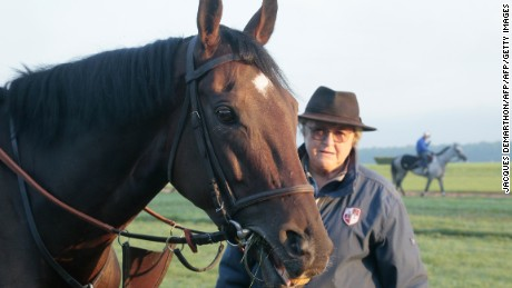 """French racehorse trainer Christiane Head-Maarek is pictured with 5-year-old French Thoroughbred racehorse """"Treve"""" in Gouvieux, north of Paris, during early training on September 23, 2015. Head is hoping to win the 94th Qatar Prix del'Arc De Triomphe horse race for the third time in a row with Treve , on October 4, 2015. AFP PHOTO / JACQUES DEMARTHON        (Photo credit should read JACQUES DEMARTHON/AFP/Getty Images)"""