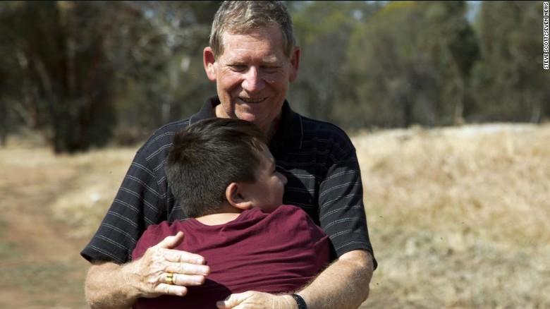 Reg hugs his son.