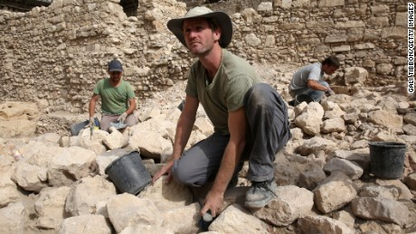 """Workers from the Israeli Antiquity Authorities dig on November 3, 2015 at the excavation site near the City of David adjacent to Jerusalem's Old City walls where researchers believe to have found the remains of the stronghold the Acra, from which the Greek King Antiochus IV was able to control Jerusalem and monitor activity at the holy site known to Jews as the Temple Mount. Israel's antiquities body claimed to have solved """"one of Jerusalem's greatest archeological mysteries"""" by unearthing from under a car park the 2,000-year-old citadel, which archaeologists have puzzled for more than a century over its location."""
